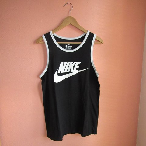 8444cac60c634c Black Nike tank top with a white outline on top. It is in - Depop