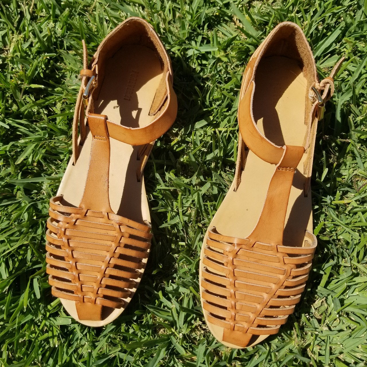 2ada40721cc4 Faux leather huarache-style sandals . Adjustable buckled