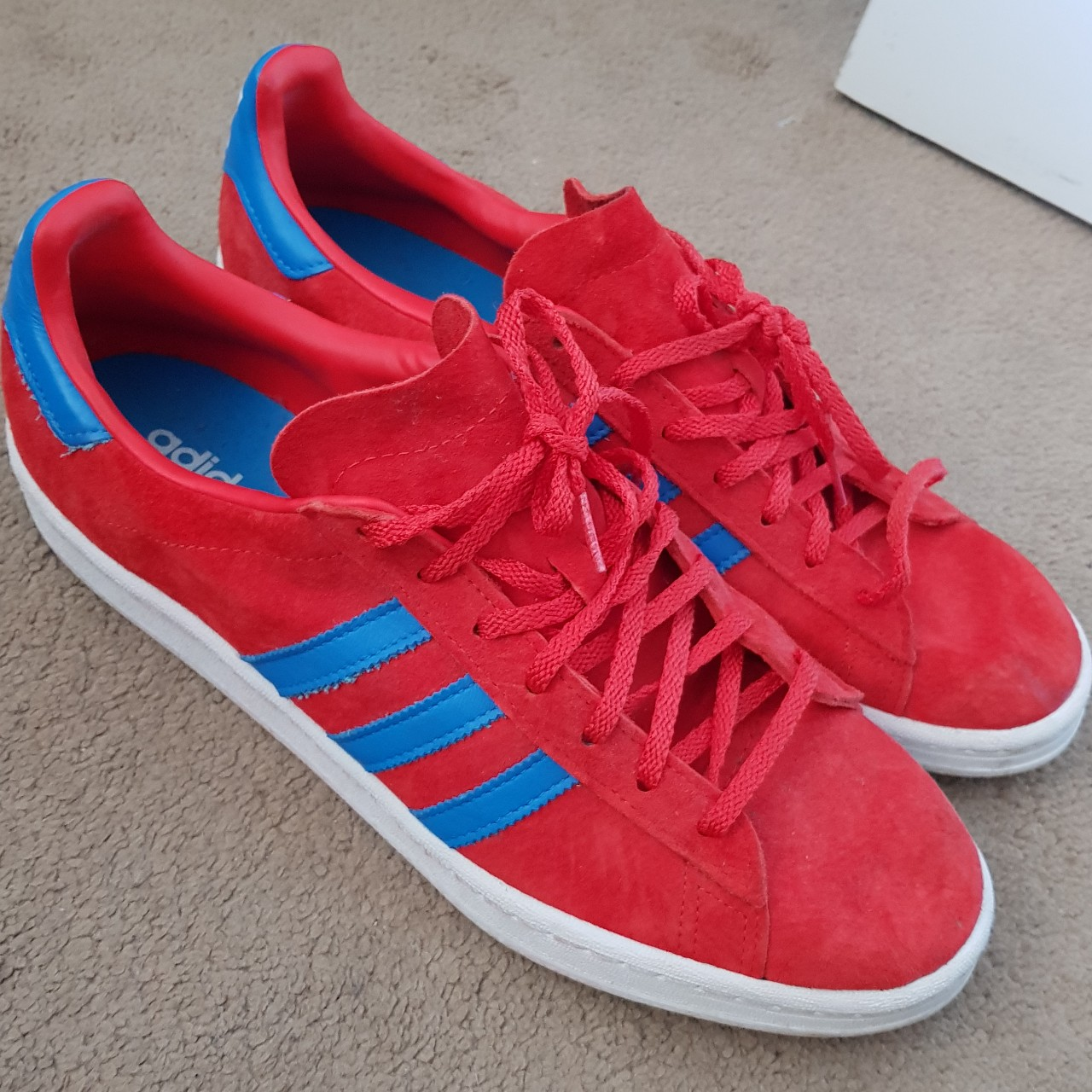 Adidas red trainers with blue stripes hardley worn...