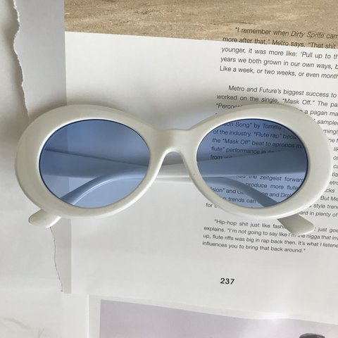 144047dca60 White oval clout sunglasses with blue lenses. Category is  - Depop