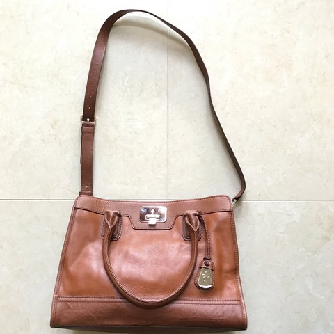 5eda328488 @cwccue. 9 months ago. Raleigh, NC, USA. Leather Cole Haan brown handbag  with shoulder strap and two ...