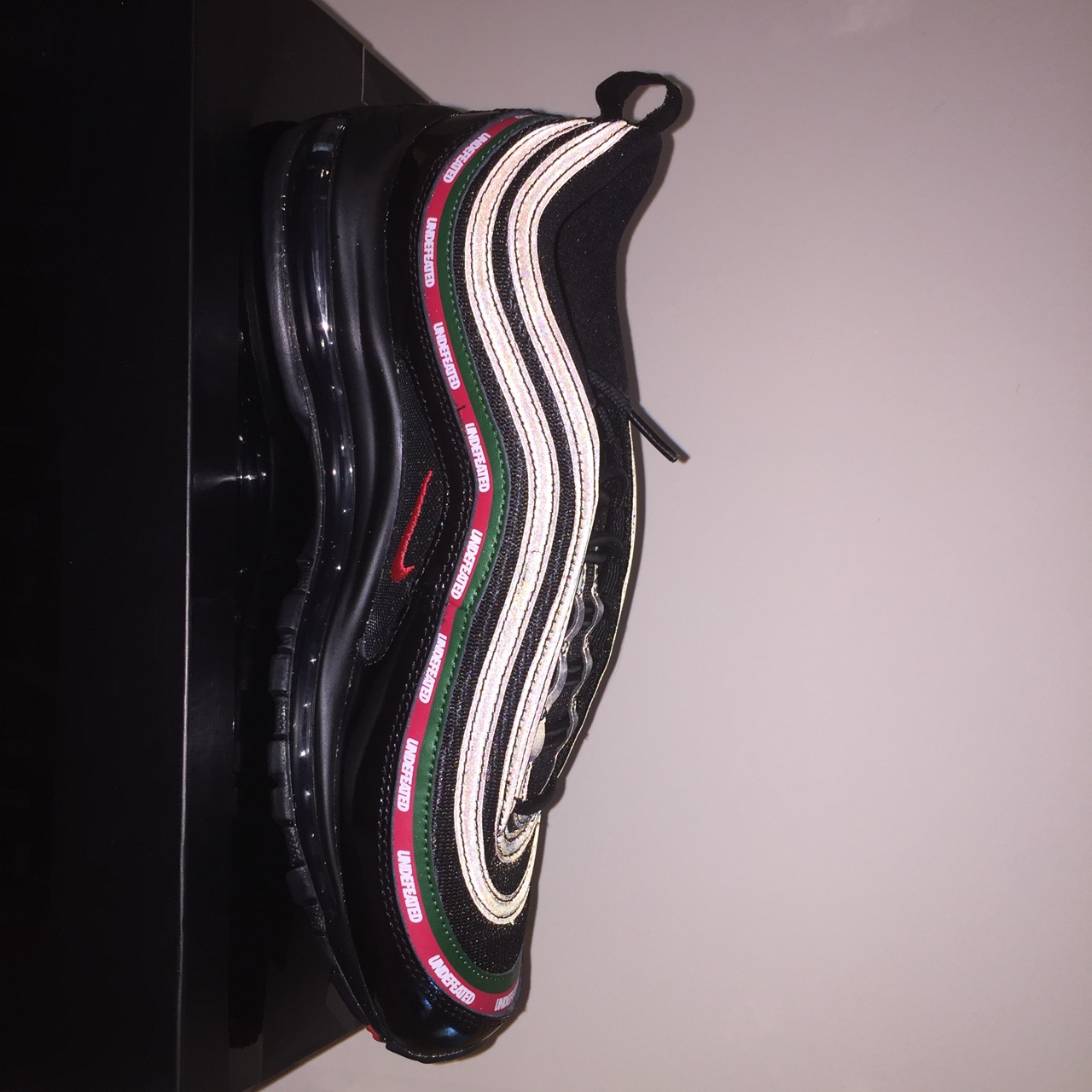 Nike Air Max 97' OG x Undefeated</p>                     </div>   <!--bof Product URL --> <!--eof Product URL --> <!--bof Quantity Discounts table --> <!--eof Quantity Discounts table --> </div>                        </dd> <dt class=