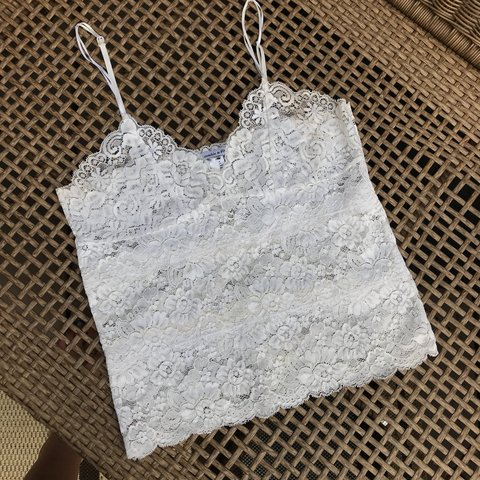 a200ecc7037 @yourpalsal. 10 months ago. Jamesville, United States. LACE QUEEN 🔥 itty  bitty hot white floral lace tank top by Abercrombie & Fitch.