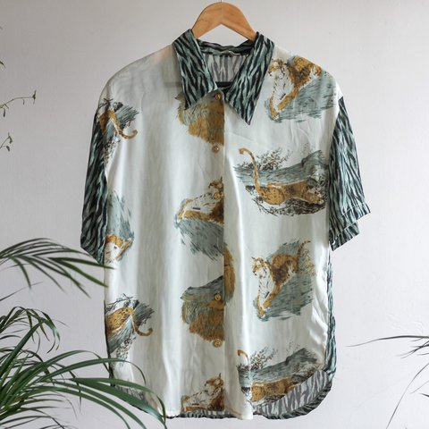 60f005ee @melonylemon. 10 months ago. London, United Kingdom. Beautiful vintage  light sheer-ish animal print Hawaii shirt.