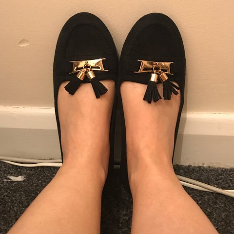 1474727e69 @sbogues2. 10 months ago. Manchester, UK. Primark black flat shoes with gold  buckle detail and tassel ...