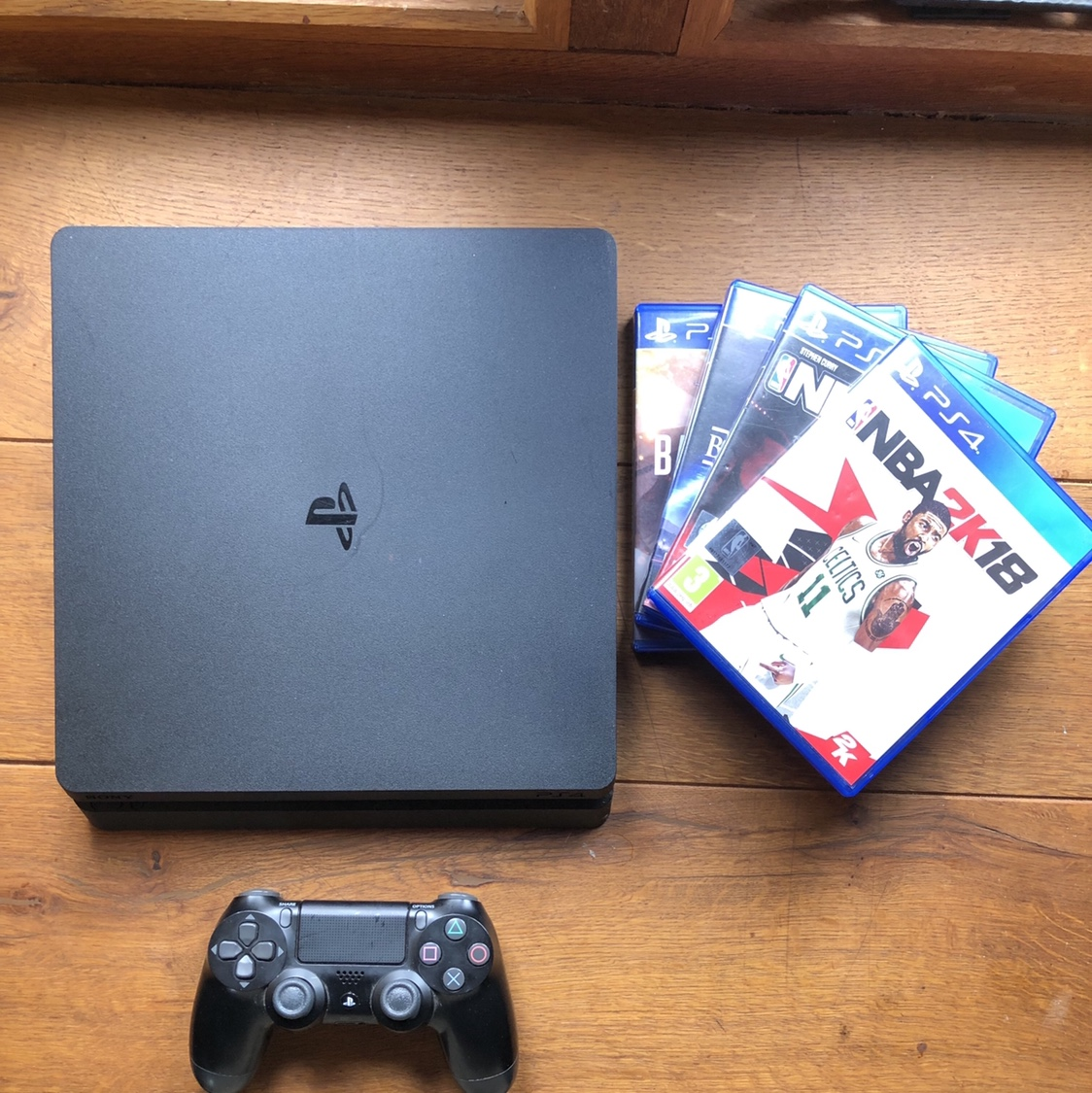 PS4 Slim, 1TB, comes with 2 controllers as well as    - Depop