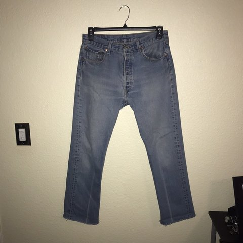 5f843587 @ismaeboi. 3 months ago. Tucson, United States. Vintage levis 501 light  wash denim jeans with cut off bottoms