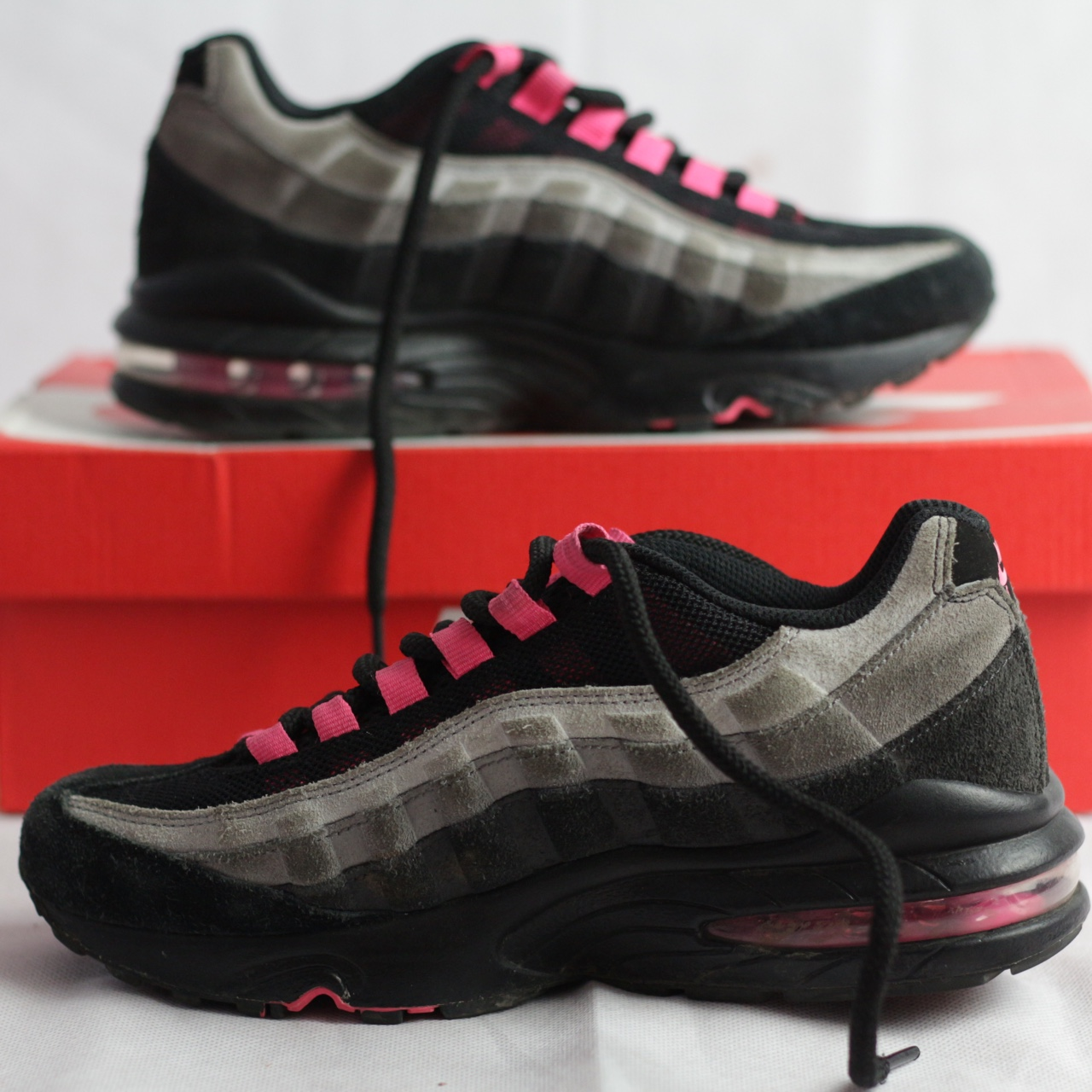 grey and pink Air Max 95 commonly known