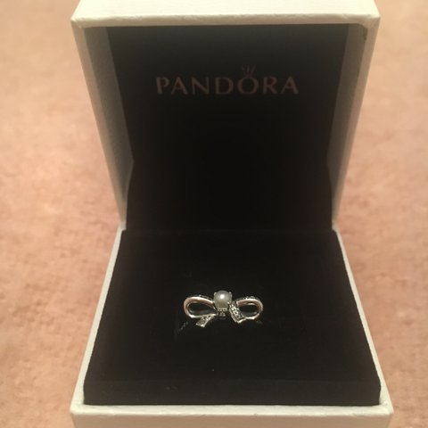 113767f30 @charlottebester25. last year. Great Abington, United Kingdom. BRAND NEW Pandora  ring SIZE 52 / L Delicate Sentiments Silver Bow Ring with Pearl.
