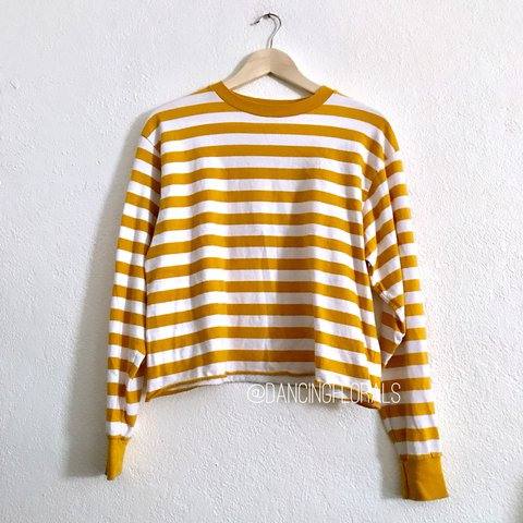 b18053ab48 @dancingflowers. 11 months ago. United States. Brandy Melville Deep yellow  mustard and white striped Acacia long sleeve top