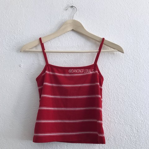 193a47f8bfe643  dancingflowers. 10 months ago. United States. Brandy Melville Faye red  white striped tank top