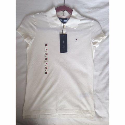 4a2d80cf @paigesa_98. 8 months ago. London, United Kingdom. Women's Tommy Hilfiger  White Polo Top XS; slim fit ...