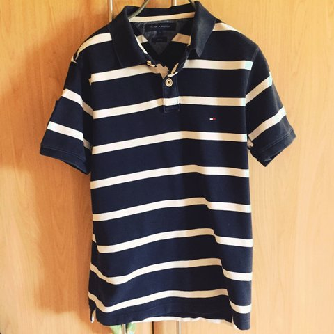 e1ce2d717 Blue and white striped Tommy Hilfiger polo shirt. Size Good - Depop