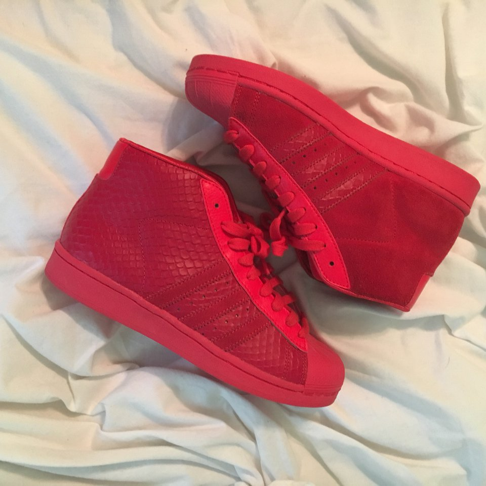 Red high top shell toe adidas, worn a