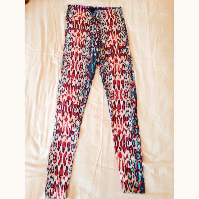f4fe42d4f864e3 @leighgeorgia. 5 years ago. Isleham, United Kingdom. Colourful Topshop  animal print leggings. Size 8.