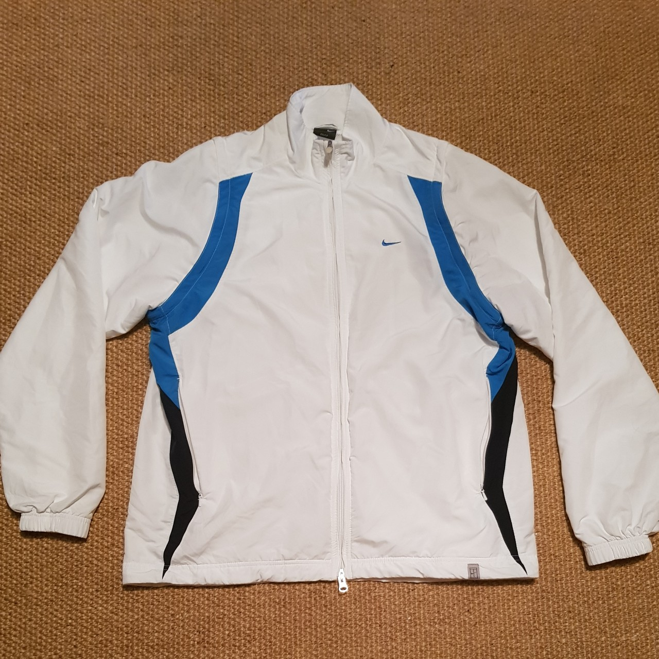 Vintage white nike sports jacket with blue and Depop