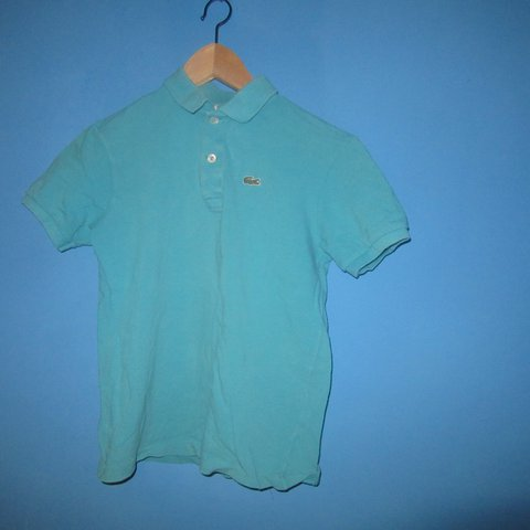 5b0d4589 @blake123456789. last year. Poole, United Kingdom. Lacoste teal t-shirt. Condition  9/10. JUNIOUR SMALL!