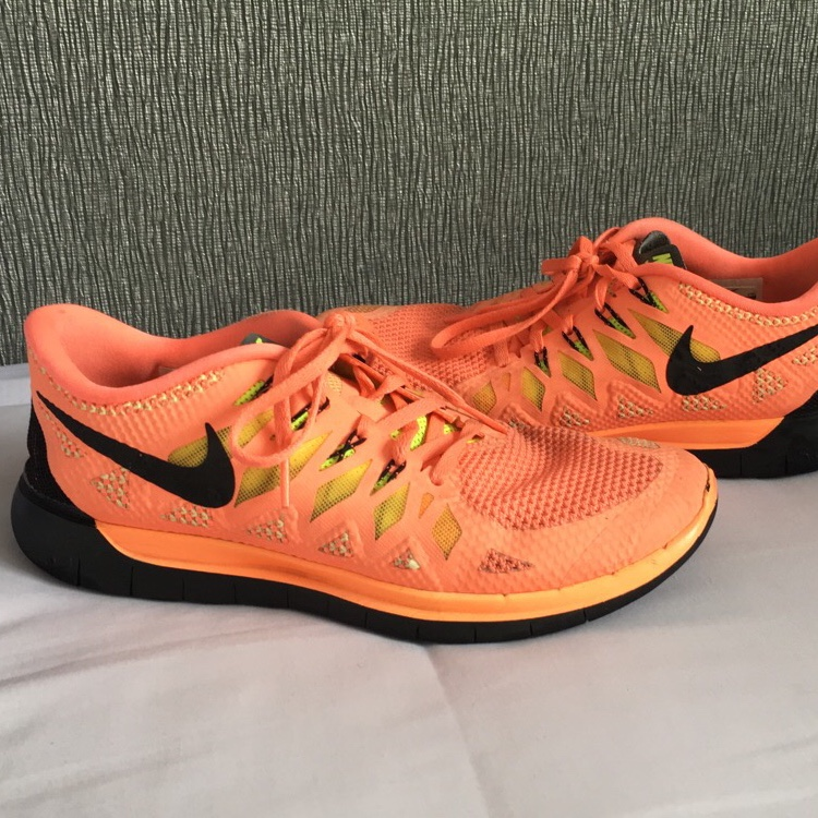 Nike Free Run 5.0 in a pinky orange colour with mesh Depop