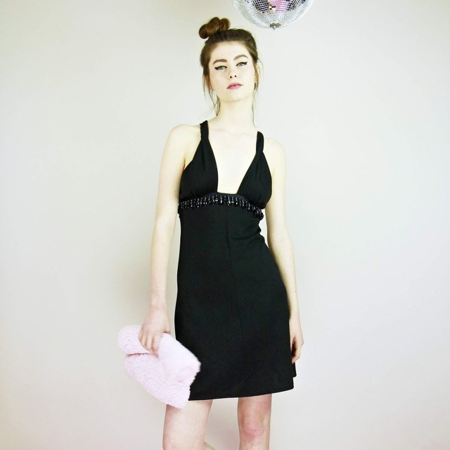 a849db93624d A stunning black beaded dress with a deep cut neck and a is - Depop
