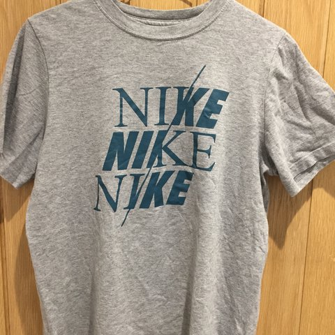 8ab00eca Boys, but suitable for all) Nike grey logo t-shirt. Size L - Depop