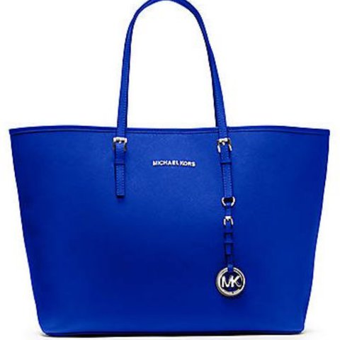 5827c2f4d38791 @astylli. 2 years ago. London, United Kingdom. Michael Kors Jet Set Travel  medium Saffiano Leather tote bag, Colour: electric blue