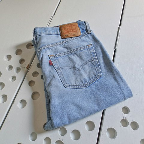 fc04db1565a @littlevisionsthrift. 2 years ago. Fayetteville, AR, USA. vintage Levis 501  button fly jeans. Made in USA