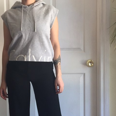 8885e4556b0ca2 Calvin Klein Sleeveless Cropped Hoodie. In amazing if not in - Depop