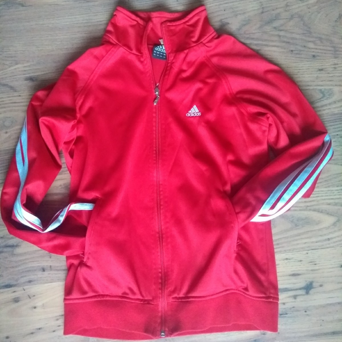 RED ADIDAS HOODIE WITH THREE WHITE STRIPES DOWN THE ARMS AND