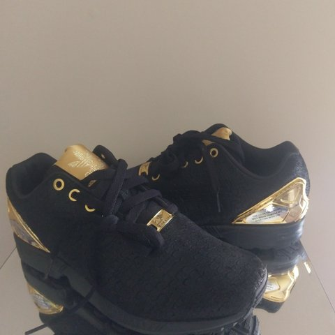 Zeer New without tag Adidas Torsion ZX Flux black and gold, suede - Depop @NX41