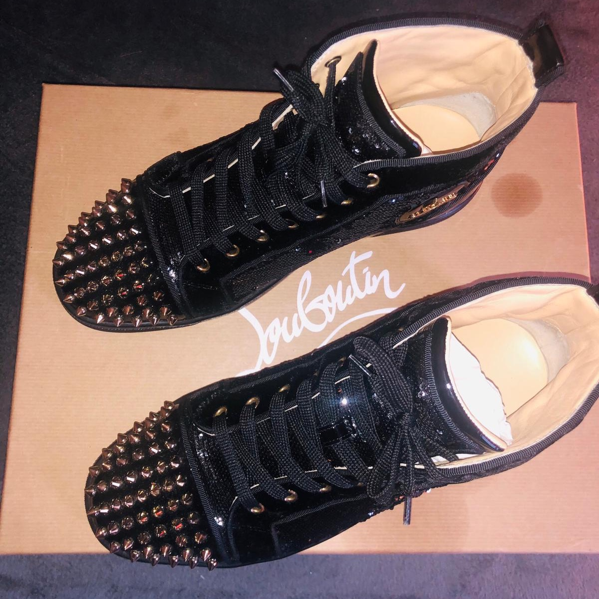 gold and black louboutins