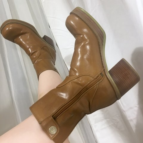 b05c01ea5adc9 @marymilk. last year. Baltimore, United States. Adorable 90s chunky caramel  colored Skechers boots with wooden platform heels.