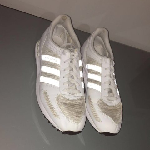 7133856edb909 White Adidas trainers LA Small black mark on back of left as - Depop