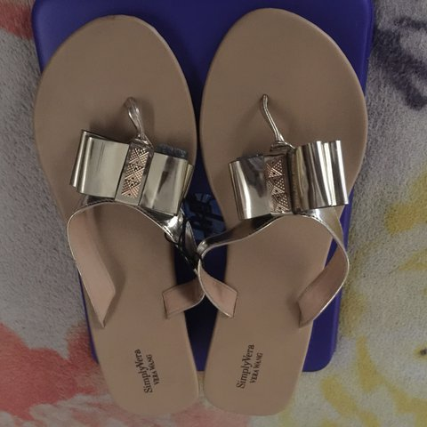 84f85eca8 Gold slip on wedge between toe flip flops - Depop
