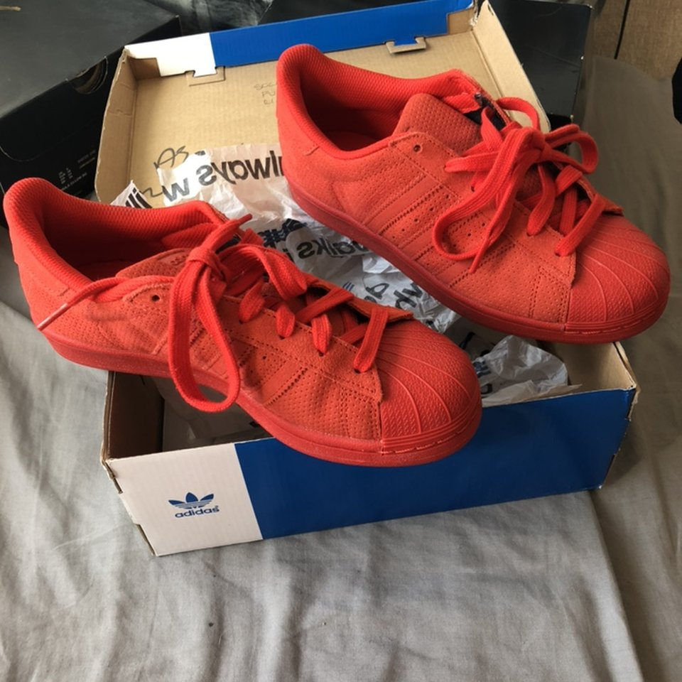 All red Adidas shell toes. Worn once