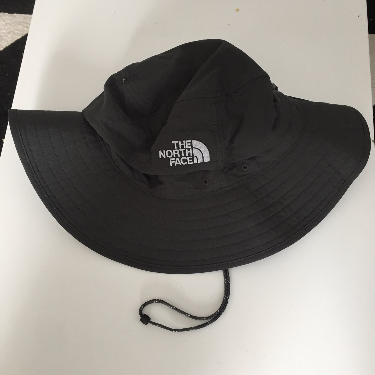 The North Face (TNF) bucket hat  boonie hat. This is a brand - Depop 980f9e5c0ec