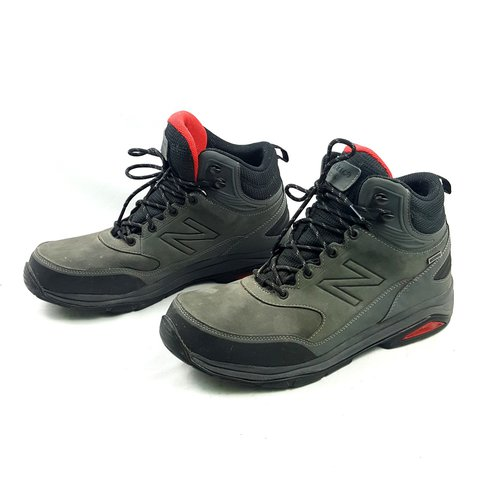 32c853bf9a3d1 This is a pair of New Balance hiking boots with grey nubuck - Depop