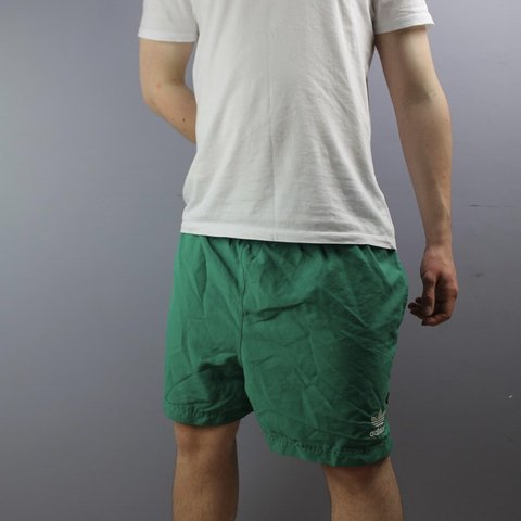 6e512cfa3 @cloutcloset. 2 months ago. Littlehampton, United Kingdom. Vintage Adidas  Shorts in Green with Pockets, Embroidered Logo and Drawstrings. Size Large.