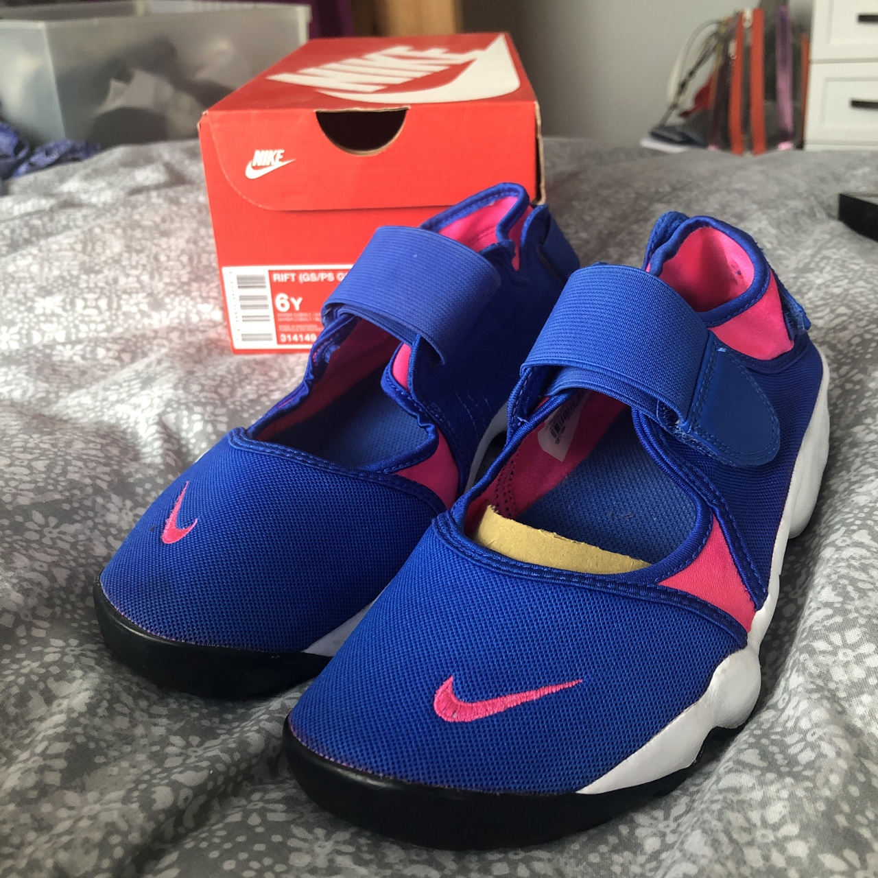Pink and blue junior Nike Rifts in a