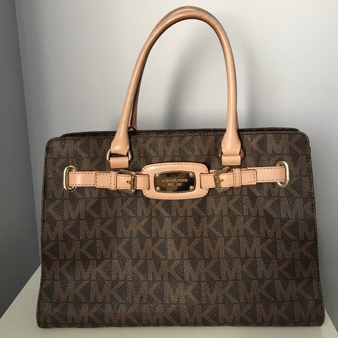 c032d582ac596e @lfulsom. last year. Grimsby, Canada. Authentic Michael Kors tote! Brown MK  patterned leather ...