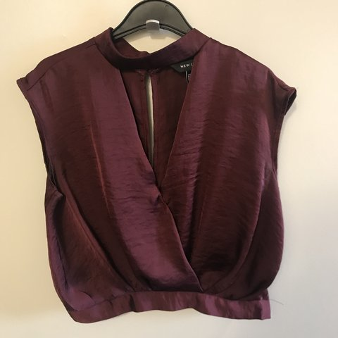 d315be373c566e @emmthomo. 4 days ago. Leeds, United Kingdom. Maroon silk cut out top. Only worn  few times