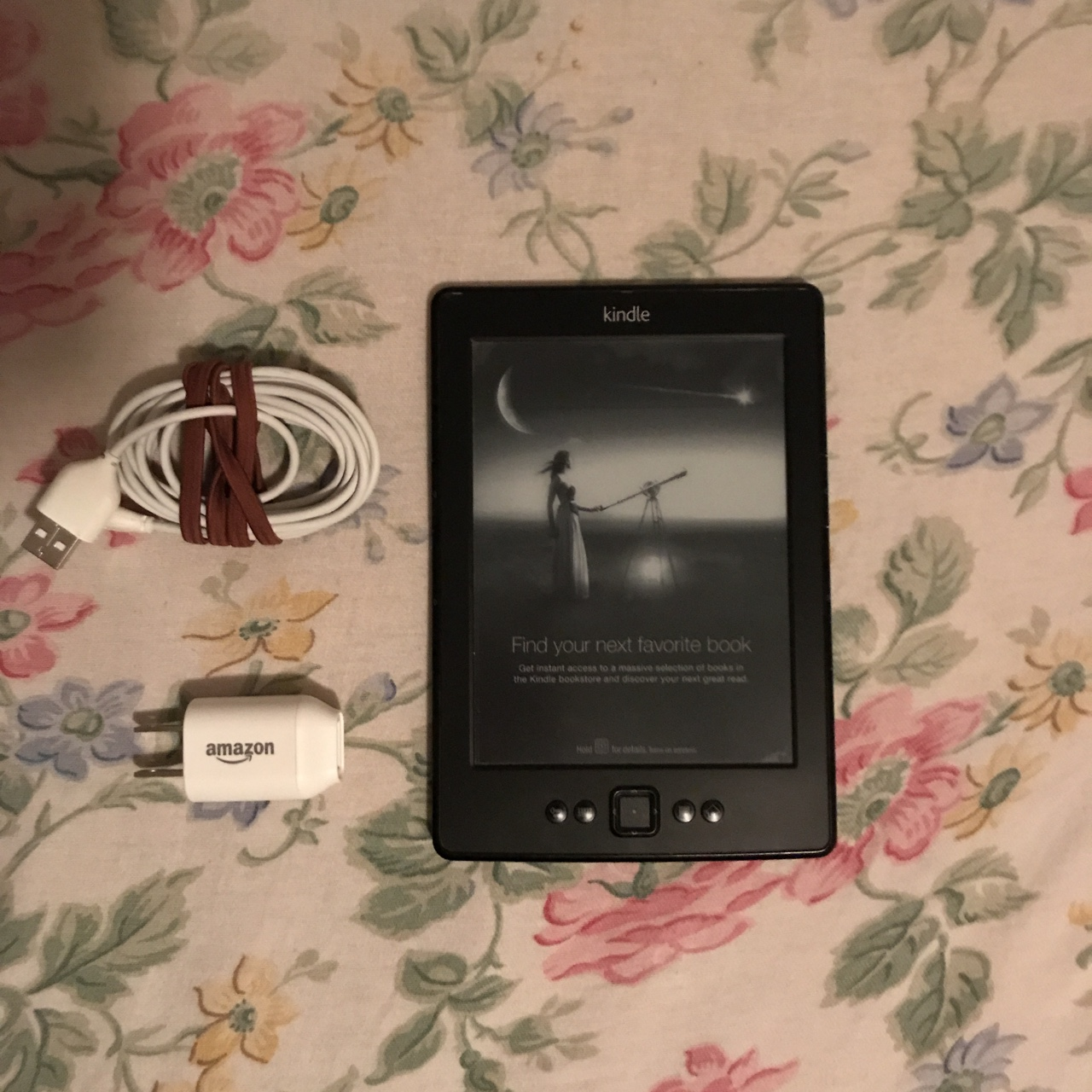 Amazon Kindle D01100  Black  Comes with charger and