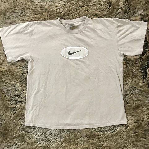 342d79423 @lolwhatidk. 10 months ago. Holbrook, United States. Vintage beige Nike  graphic t shirt. Excellent condition. Men's size large