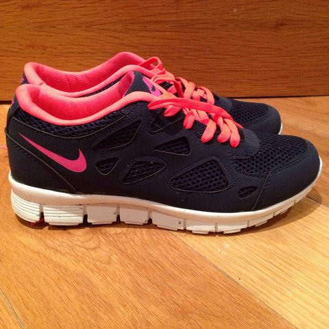 ed64d6b59f7a Navy and pink Nike Runners