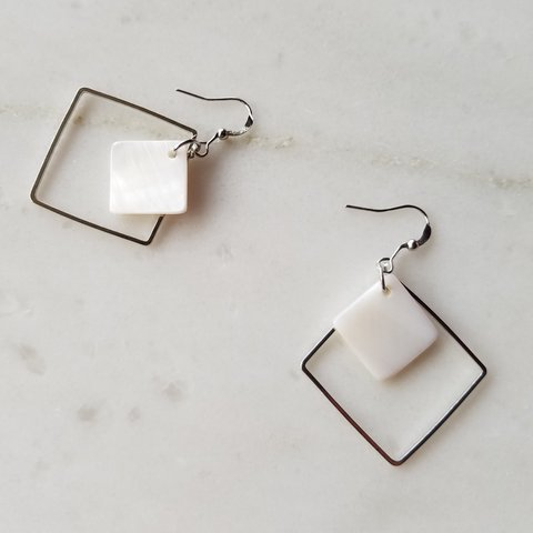 cd03bf942e615b @butterflyrose. 2 months ago. Portland, Multnomah County, United States. Silver  square earrings with a square white accent interior.