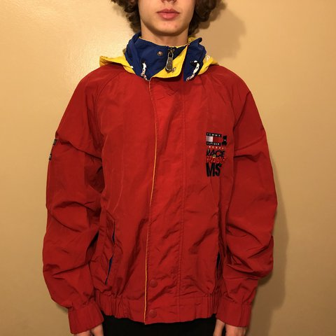 7bc5bc21 @izzycra. last year. Des Moines, United States. Red Tommy Hilfiger  windbreaker with yellow hood. Great condition! Size ...