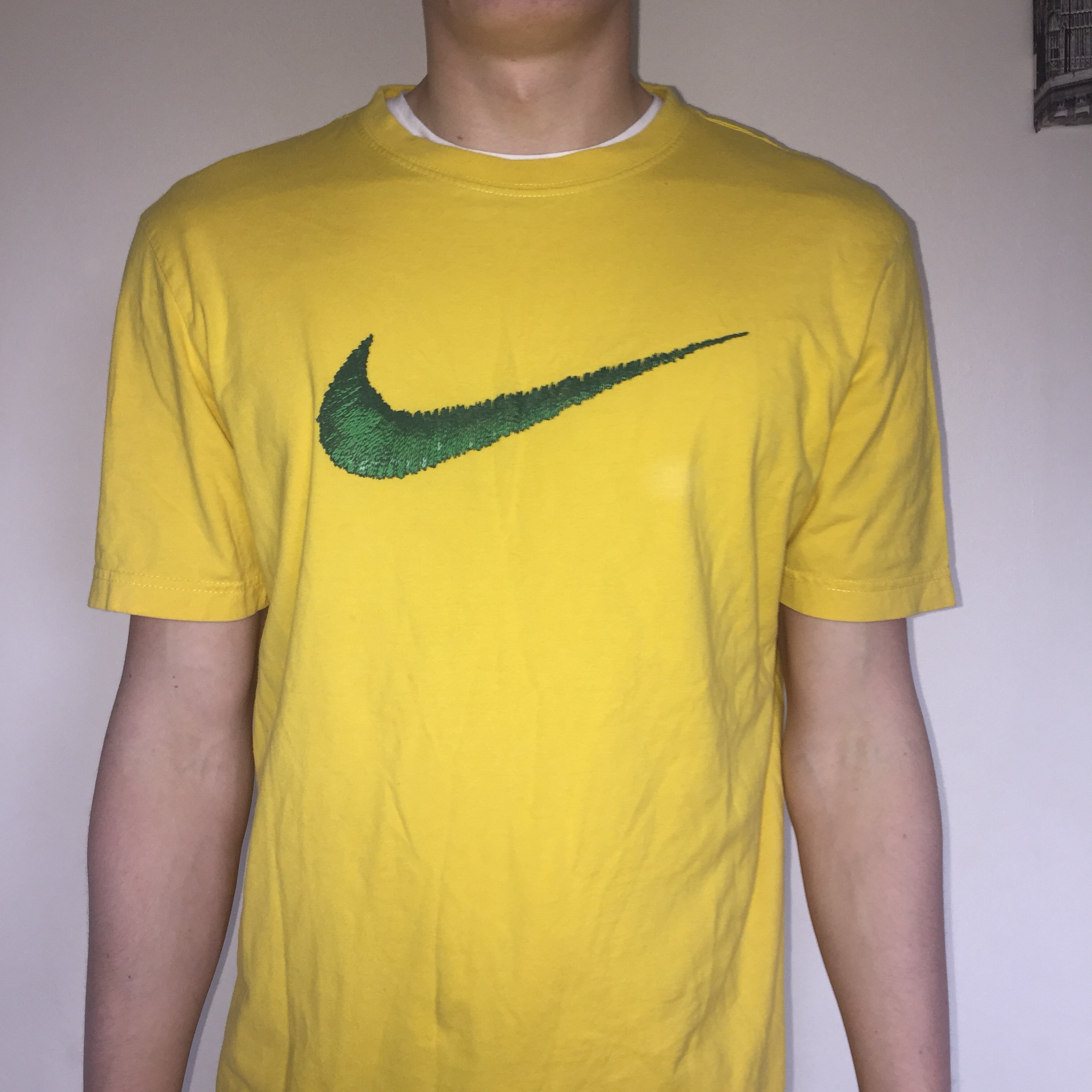 Yellow t-shirt with a green Nike tick
