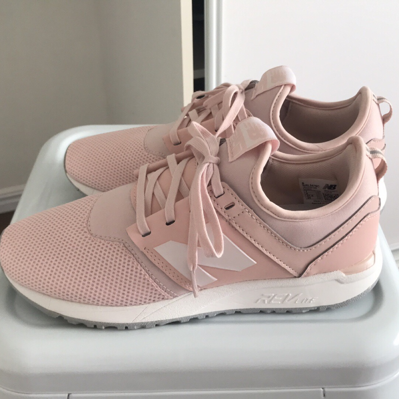 Size ladies 7 AU, new balance 247 shoes. Never been...
