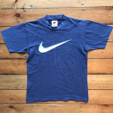 dc5a69ff @beauclaytz. in 19 hours. London, United Kingdom. Vintage 90s old tag/white  tag Nike swoosh logo navy blue t-shirt/tee