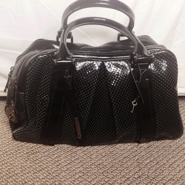e55ddb797cbf Limited Edition Authentic Burberry hold all bag. In black as - Depop