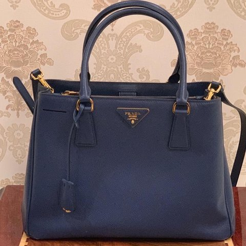 a0817ab43390 @saraalfaihani. 29 days ago. United Kingdom. Prada Saffiano Leather Handbag
